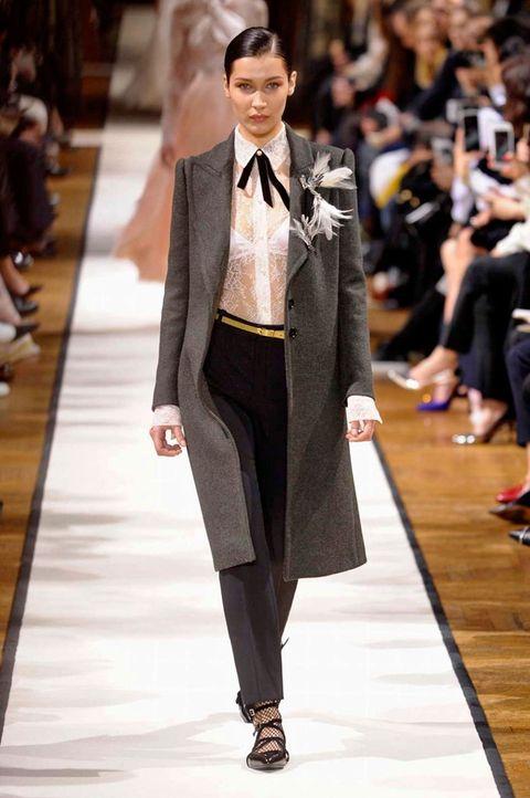 Fashion model, Fashion, Runway, Fashion show, Clothing, Formal wear, Suit, Haute couture, Outerwear, Footwear,