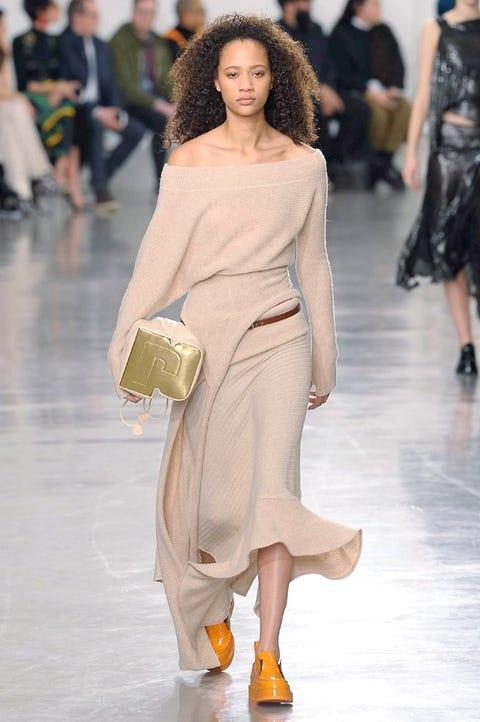 Fashion model, Fashion, Fashion show, Runway, Shoulder, Clothing, Haute couture, Joint, Waist, Footwear,