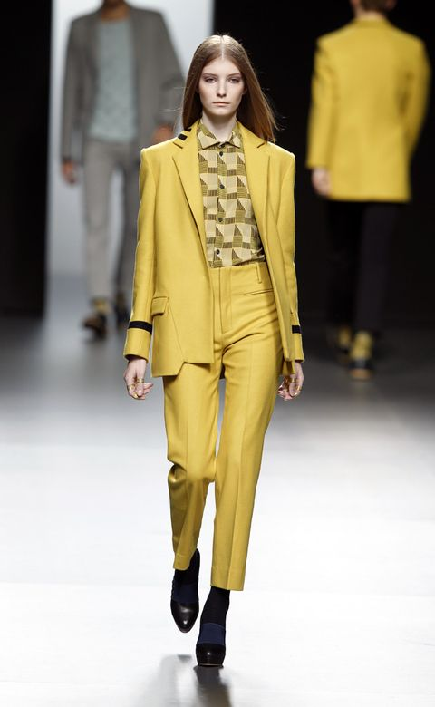Clothing, Yellow, Sleeve, Fashion show, Shoulder, Joint, Outerwear, Runway, Fashion model, Style,