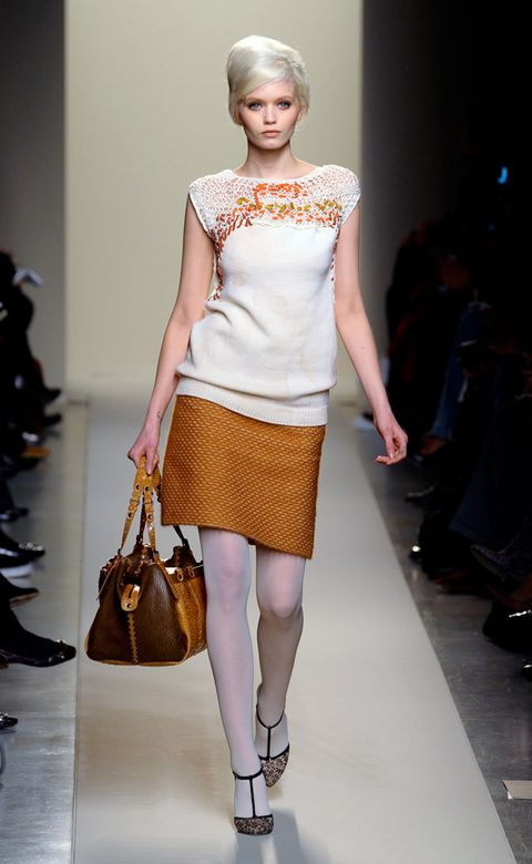 Clothing, Footwear, Brown, Shoulder, Textile, Joint, Style, Fashion accessory, Beauty, Waist,