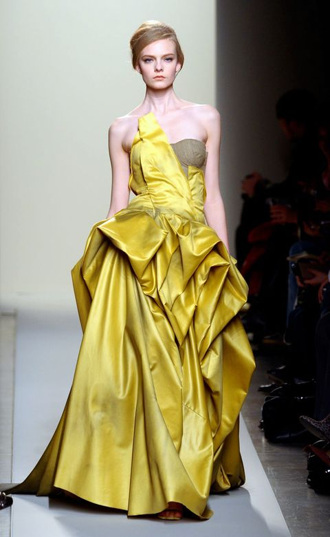 Clothing, Yellow, Hairstyle, Shoulder, Dress, Textile, Joint, Formal wear, Fashion model, One-piece garment,