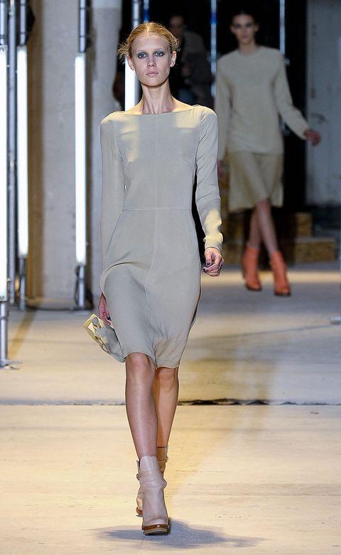Clothing, Leg, Fashion show, Sleeve, Human body, Shoulder, Human leg, Joint, Runway, Fashion model,