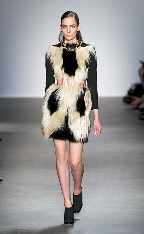 Clothing, Human, Skin, Fashion show, Human body, Shoulder, Human leg, Textile, Joint, Runway,