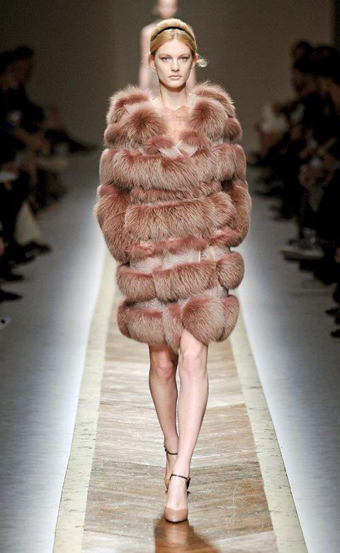 Leg, Fashion show, Skin, Shoulder, Textile, Human leg, Runway, Joint, Fashion model, Style,