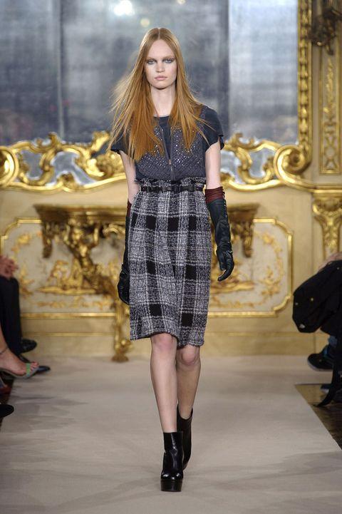 Footwear, Leg, Sleeve, Human body, Dress, Shoulder, Joint, Human leg, Style, Fashion model,