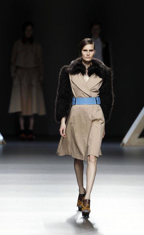 Clothing, Human, Leg, Fashion show, Brown, Human body, Runway, Shoulder, Human leg, Joint,
