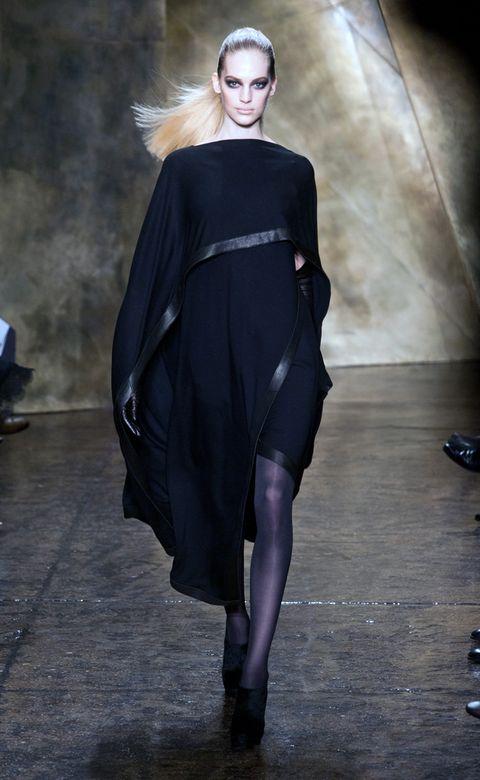 Clothing, Sleeve, Dress, Shoulder, Fashion model, Style, Fashion show, One-piece garment, Fashion, Black,