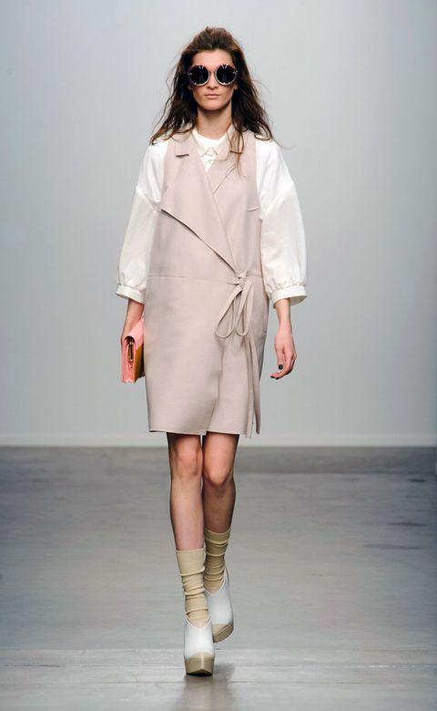 Clothing, Eyewear, Sleeve, Fashion show, Shoulder, Human leg, Joint, Outerwear, Fashion model, Style,