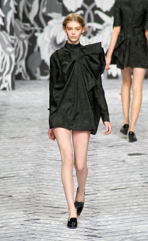 Clothing, Leg, Fashion show, Human body, Event, Dress, Shoulder, Human leg, Runway, Joint,