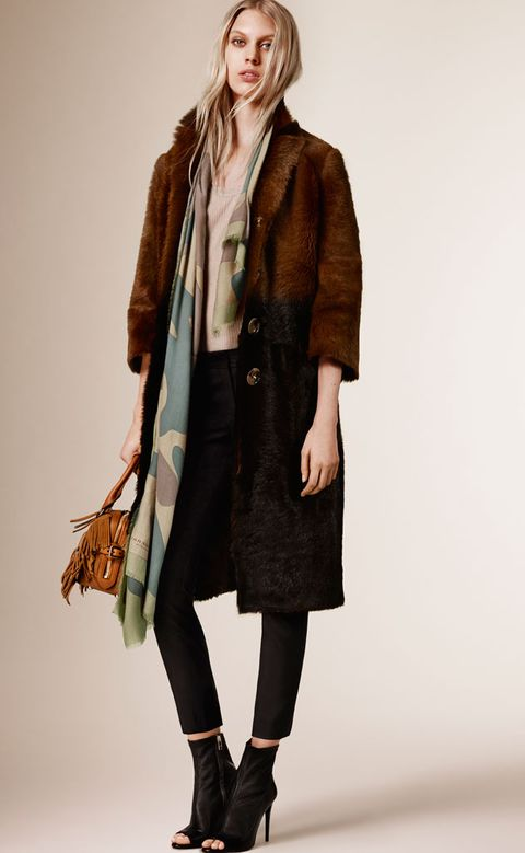 Clothing, Brown, Sleeve, Human body, Coat, Shoulder, Textile, Joint, Outerwear, Jacket,