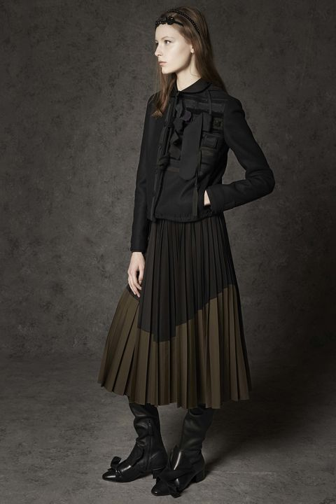 Clothing, Brown, Sleeve, Shoulder, Collar, Textile, Joint, Standing, Style, Formal wear,