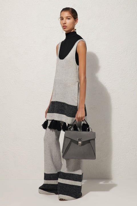 Brown, Sleeve, Shoulder, Textile, Joint, White, Bag, Style, Elbow, Waist,