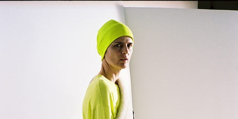 Yellow, Sleeve, Shoulder, Standing, Joint, Cap, Elbow, Knee, Active pants, Street fashion,