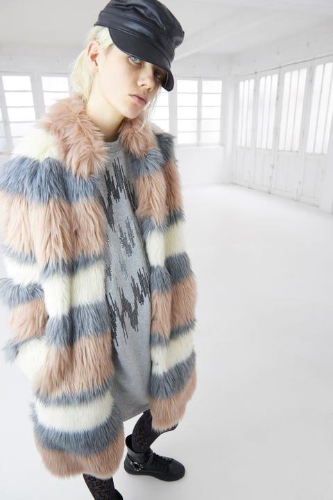 Sleeve, Winter, Shoulder, Cap, Textile, Joint, Pattern, Outerwear, Street fashion, Jacket,