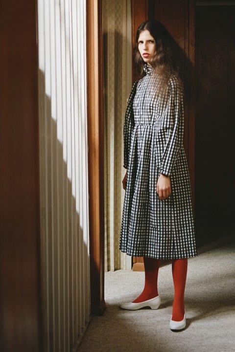 Sleeve, Dress, Street fashion, Pattern, One-piece garment, Fashion model, Woolen, Long hair, Day dress, Fashion design,
