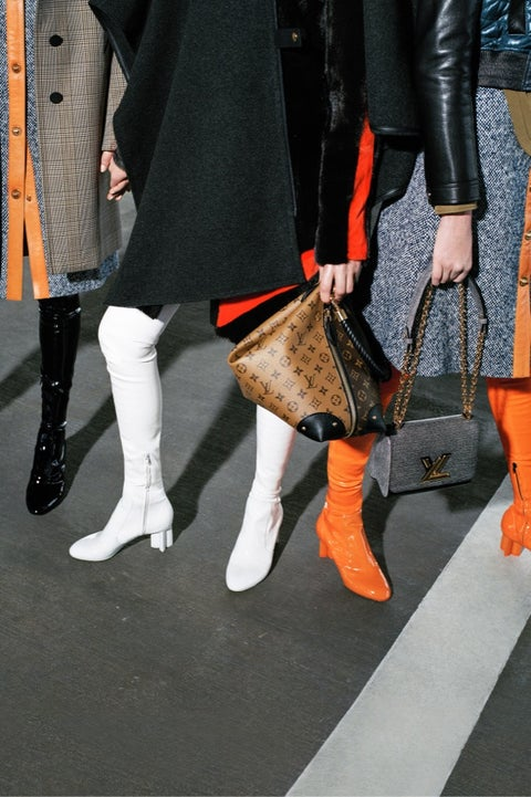 Human leg, Orange, Footwear, Leg, Fur, Street fashion, Fashion, Knee, Ankle, Boot,