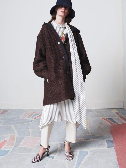 Clothing, Outerwear, Fashion, Coat, Neck, Headgear, Street fashion, Beige, Costume, Woolen,