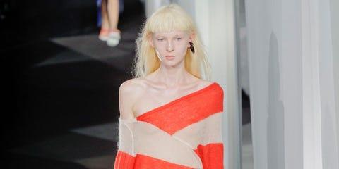 Sleeve, Shoulder, Textile, Joint, Standing, Style, Street fashion, Fashion, Orange, Fashion model,