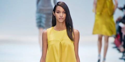 Leg, Yellow, Sleeve, Human leg, Shoulder, Joint, Fashion show, Standing, Waist, Style,