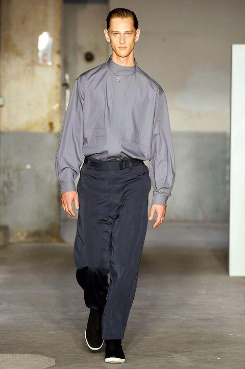 Fashion, Clothing, Fashion model, Fashion show, Runway, Dress shirt, Human, Standing, Shirt, Denim,