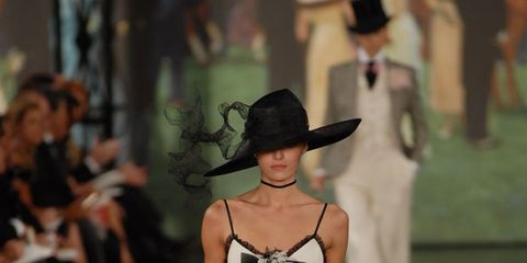 Hat, Shoulder, Joint, Fashion show, Style, Runway, Formal wear, Waist, Fashion model, Fashion,