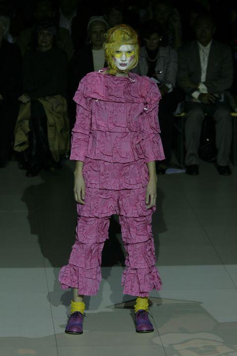 Purple, Fashion, Costume design, Costume, Magenta, Mask, Lavender, Fashion design, Fictional character, Visual arts,