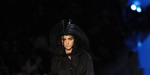 Fashion show, Darkness, Fashion, Jacket, Runway, Fashion model, Street fashion, Midnight, Boot, Fashion design,