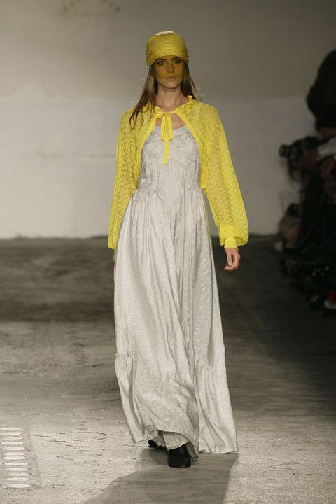 Dress, Fashion, Costume design, Fashion model, Street fashion, One-piece garment, High heels, Fashion design, Headpiece, Gown,