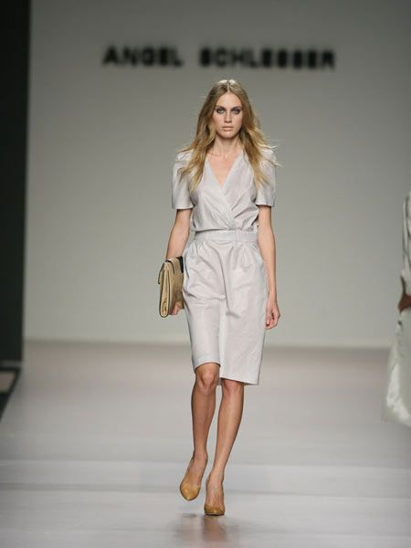 Brown, Shoulder, Human leg, Fashion show, Joint, Runway, Style, Fashion model, Waist, Knee,