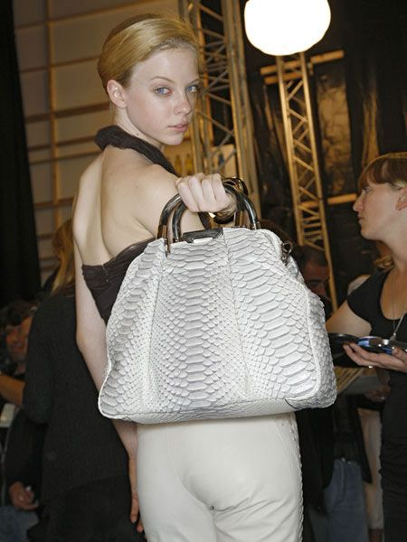 Shoulder, Bag, Joint, Luggage and bags, Shoulder bag, Light fixture, Street fashion, Blond, Handbag, Curtain,