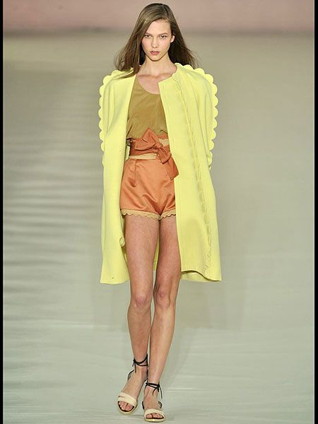 Leg, Yellow, Fashion show, Human leg, Shoulder, Joint, Runway, Style, Fashion model, High heels,