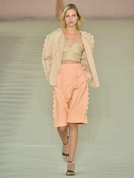 Sleeve, Shoulder, Human leg, Joint, Style, Fashion show, Fashion model, Fashion accessory, Knee, Peach,
