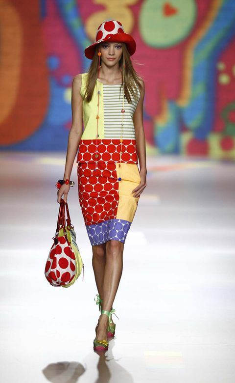 Clothing, Shoulder, Textile, Red, Joint, Hat, Fashion show, Fashion accessory, Style, Street fashion,