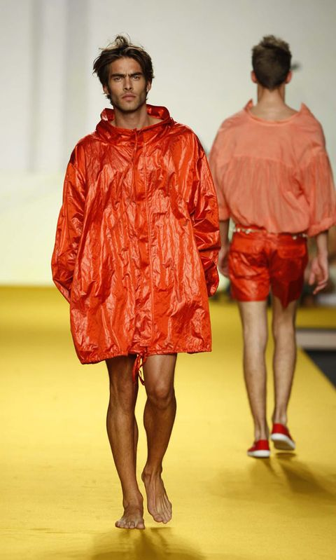 Leg, Sleeve, Human leg, Shoulder, Red, Joint, Style, Fashion show, Fashion model, One-piece garment,