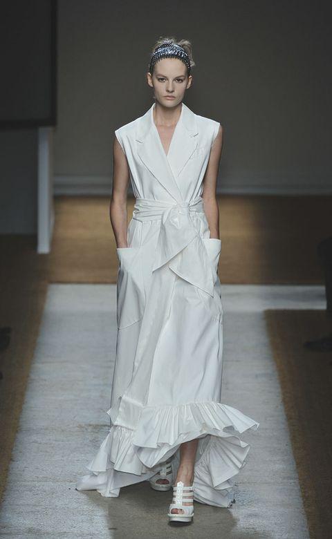 Clothing, Shoulder, Textile, Fashion show, Dress, Style, Formal wear, One-piece garment, Gown, Fashion model,