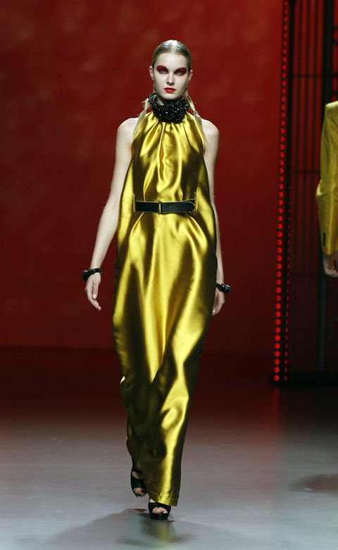 Yellow, Fashion show, Style, Runway, Fashion model, Fashion, One-piece garment, Model, Costume design, Waist,