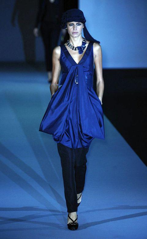 Blue, Fashion show, Shoulder, Joint, Runway, Fashion model, Style, Electric blue, Cobalt blue, Fashion,
