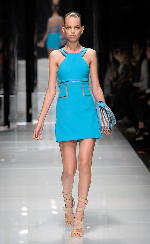 Fashion show, Human leg, Skin, Shoulder, Dress, Fashion model, Joint, Runway, One-piece garment, Style,