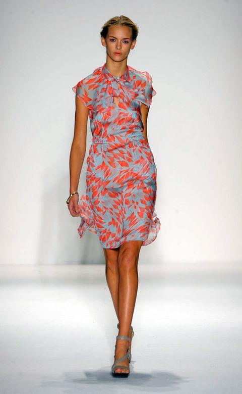 Clothing, Dress, Fashion show, Shoulder, Human leg, Textile, Joint, One-piece garment, Red, Fashion model,