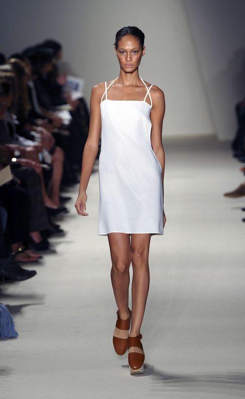 Fashion show, Shoulder, Runway, Human leg, Joint, Dress, Fashion model, Style, Summer, One-piece garment,