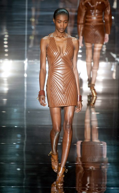 Brown, Fashion show, Skin, Shoulder, Human leg, Joint, Runway, Fashion model, Style, Waist,