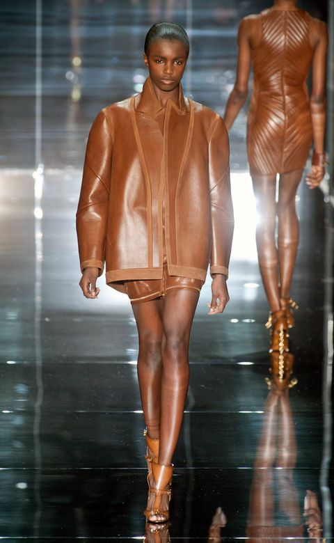 Brown, Fashion show, Textile, Joint, Style, Runway, Fashion model, Amber, Jacket, Tan,
