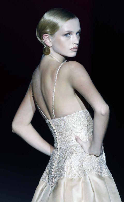 Clothing, Ear, Hairstyle, Dress, Shoulder, Joint, Style, Earrings, Formal wear, Eyelash,
