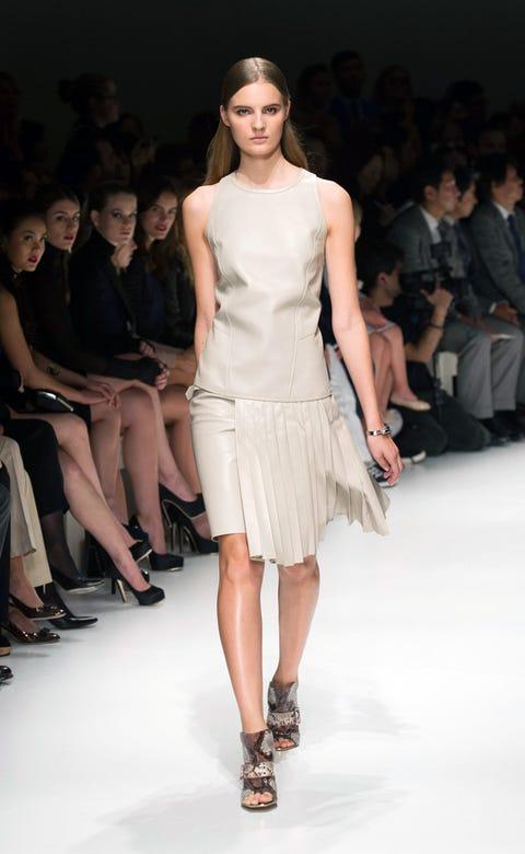 Clothing, Footwear, Leg, Human, Fashion show, Event, Hairstyle, Skin, Human leg, Human body,