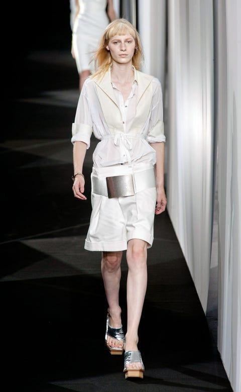Clothing, Sleeve, Human leg, Shoulder, Joint, White, Style, Fashion model, Fashion show, Sandal,