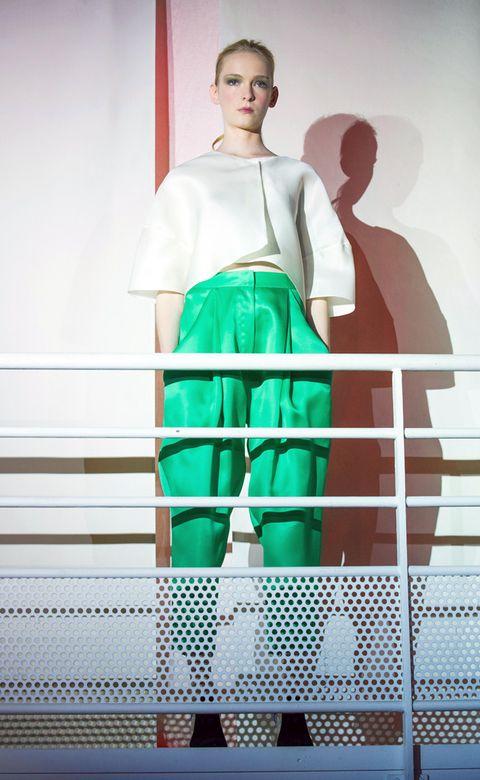 Sleeve, Shoulder, Standing, Knee, Waist, Teal, Active pants, Active shorts, Fashion design, Fence,
