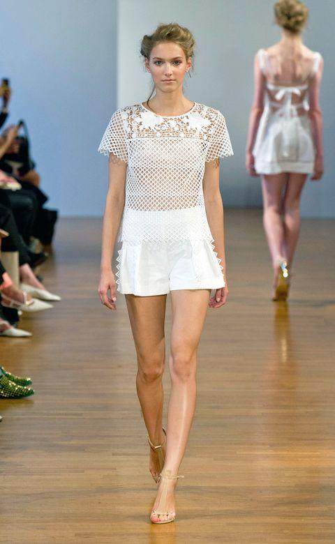Clothing, Leg, Fashion show, Brown, Shoulder, Human leg, Joint, Runway, Fashion model, Waist,