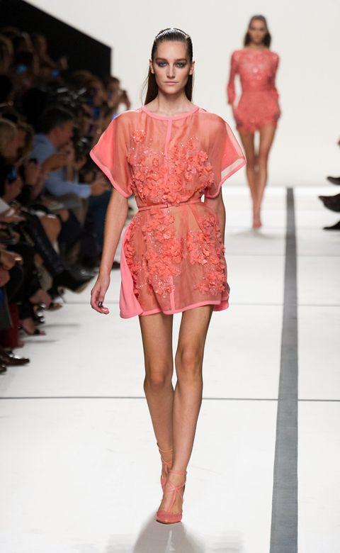 Clothing, Leg, Fashion show, Event, Human leg, Shoulder, Runway, Red, Joint, Fashion model,