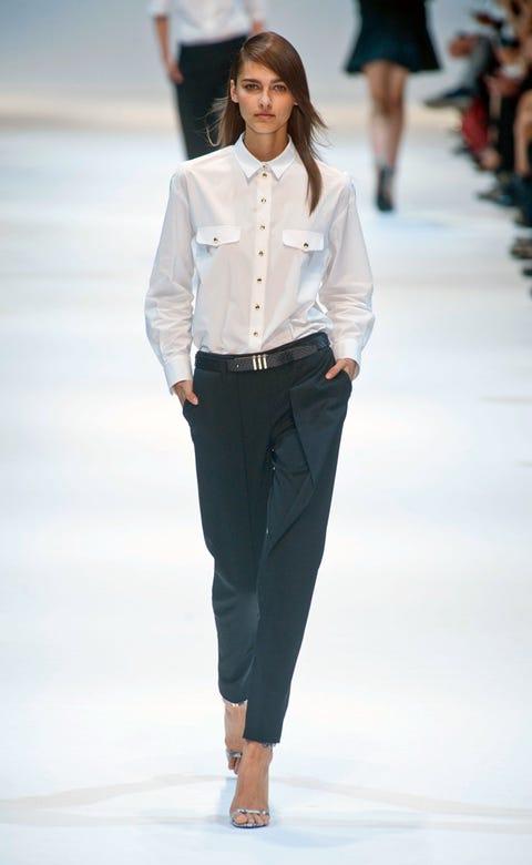 Clothing, Leg, Brown, Collar, Sleeve, Fashion show, Shoulder, Dress shirt, Textile, Joint,