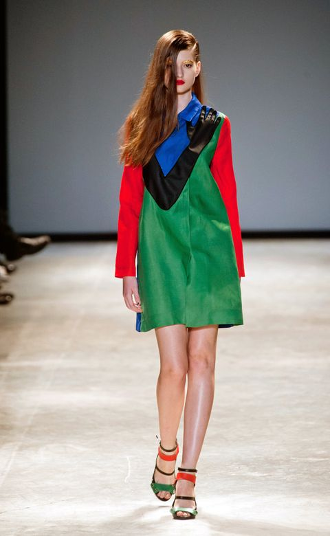 Clothing, Shoulder, Fashion show, Human leg, Joint, Outerwear, Red, Runway, Style, Fashion model,